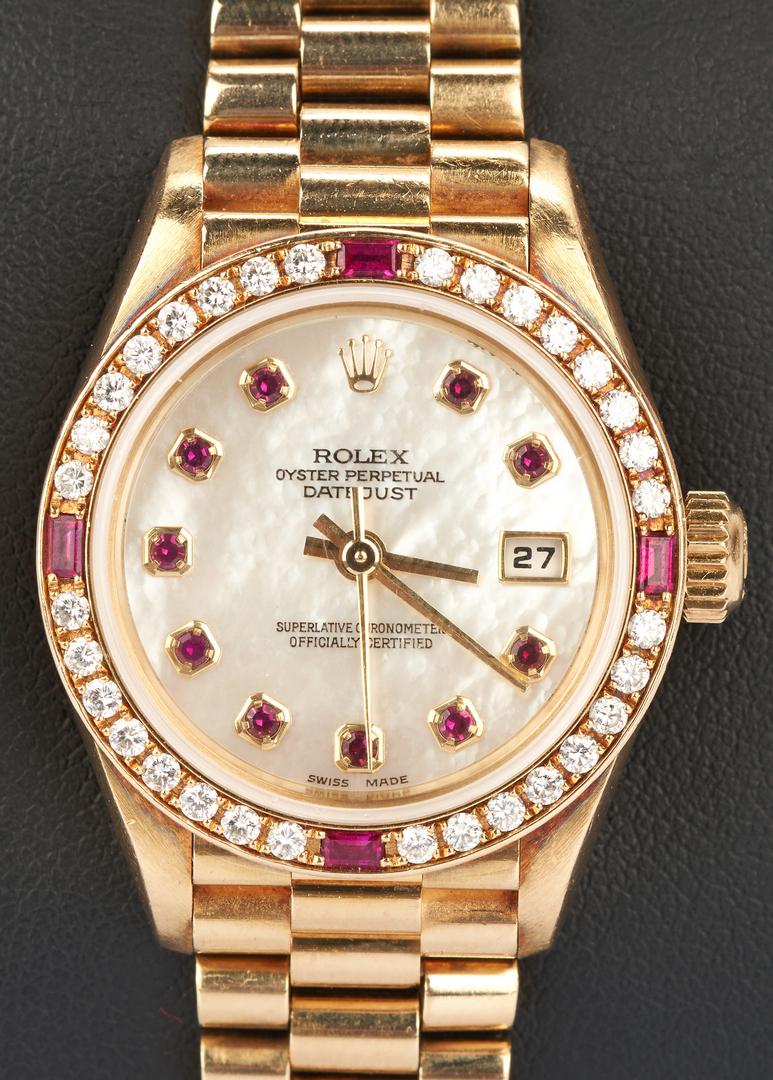 Lot 43: Ladies 18K Rolex Watch w/ Diamond & Ruby Bezel