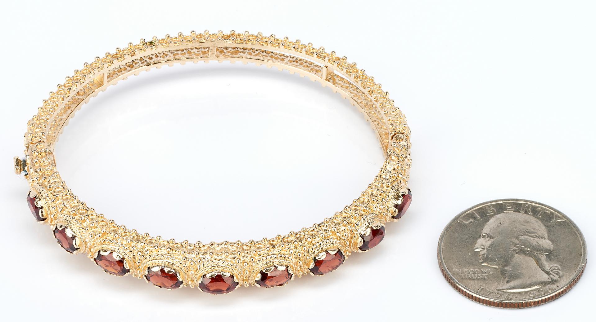 Lot 444: Ladies 14K Yellow Gold & Garnet Bangle Bracelet