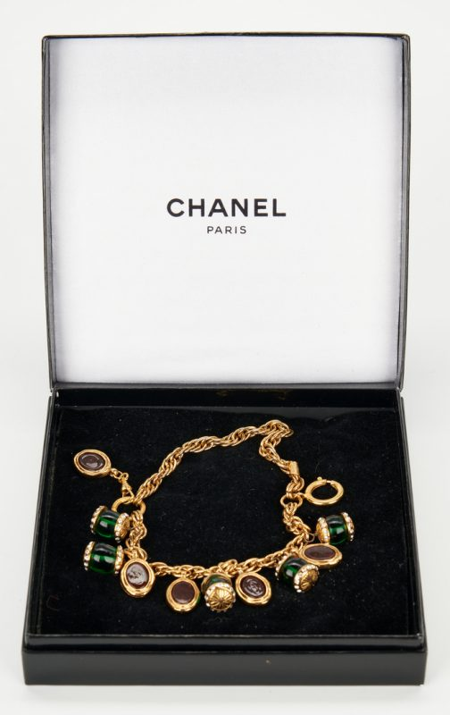 Lot 723: Chanel Gripoix Red & Green Gold Tone Charm Bracelet
