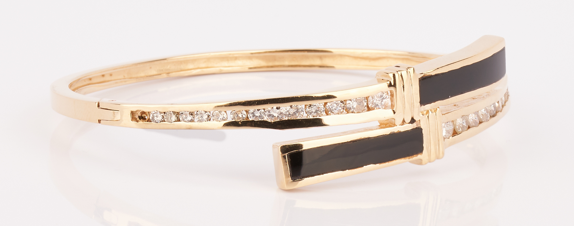 Lot 729: Ladies 14K Black Onyx & Diamond Bangle Bracelet