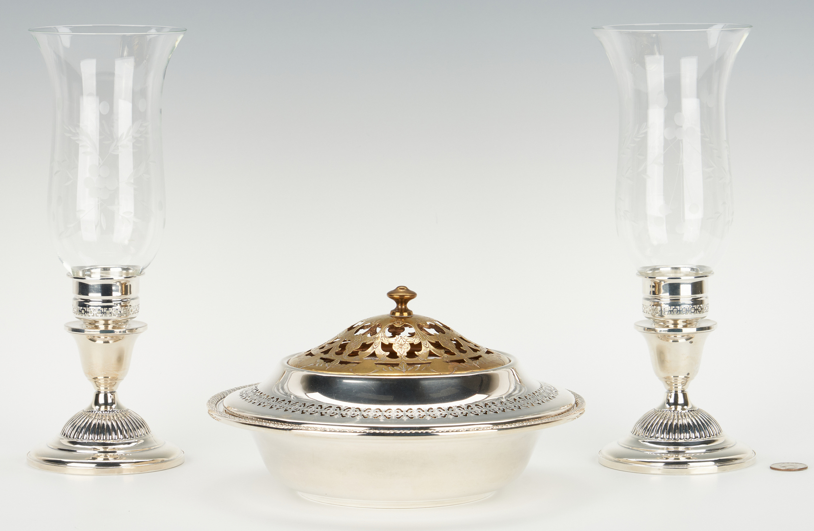 Lot 945: Sterling bowls incl. flower frog, plus candlestick lamps