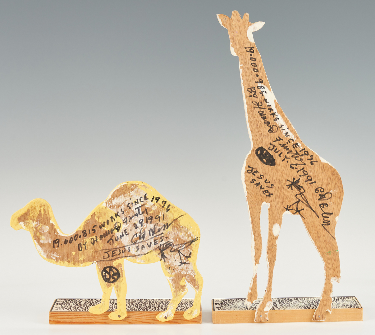 Lot 154: Howard Finster Folk Art Camel & Giraffe Bookends