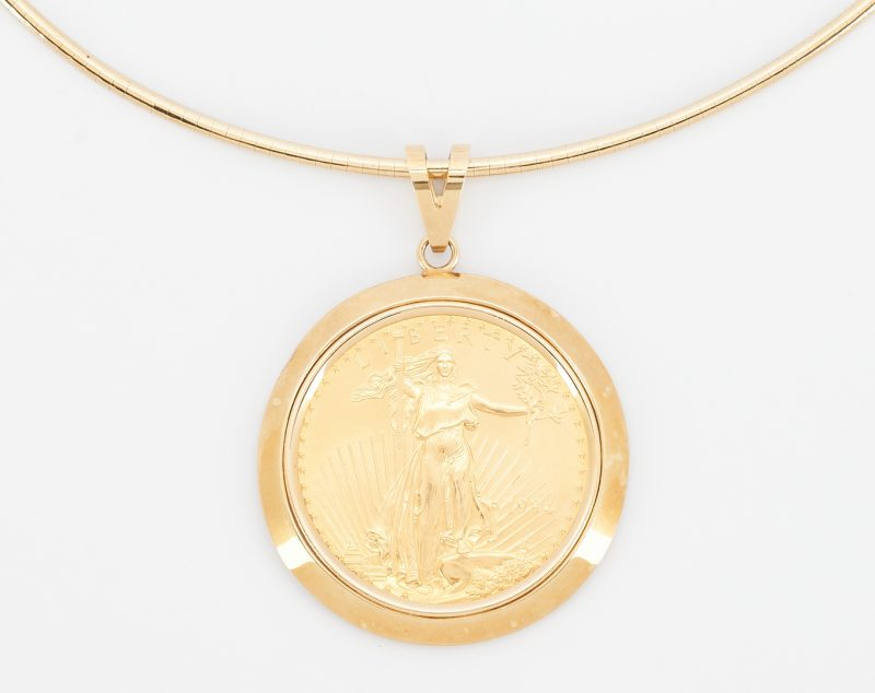 Lot 259: 14K Gold Necklace & Bezel w/ American Eagle Coin