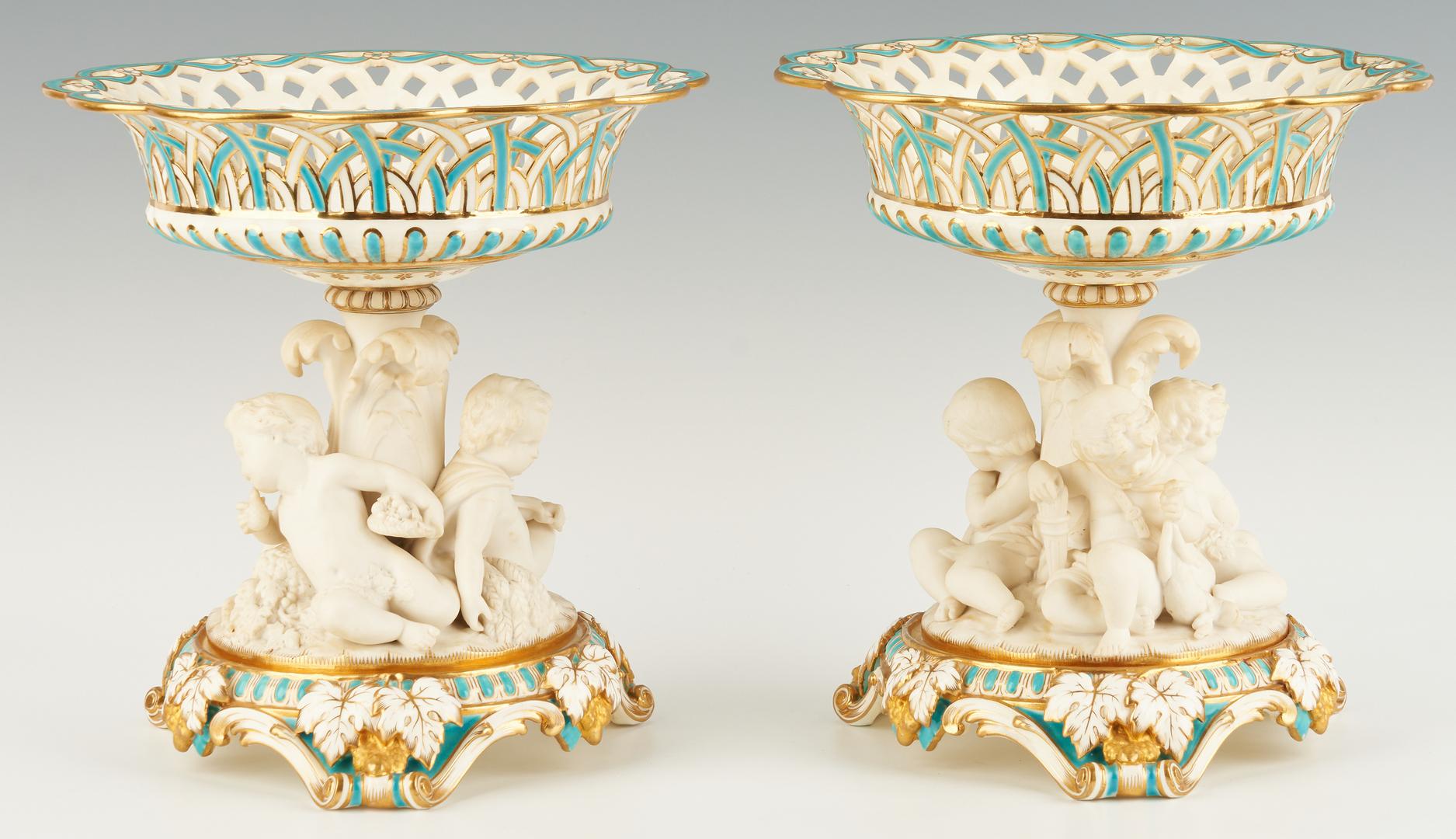 Lot 310: Pair Porcelain Corbeilles with Bisque Putti
