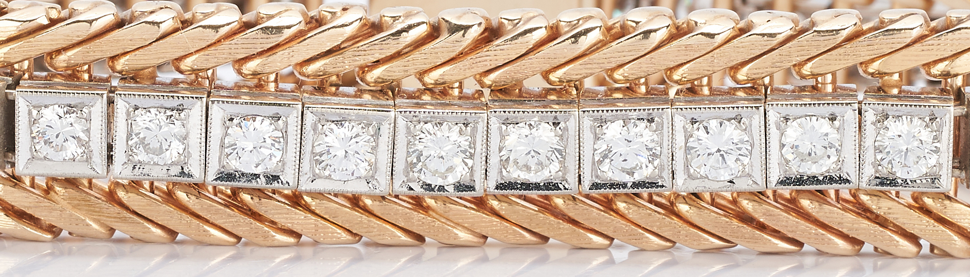Lot 33: 14K Gold and Diamond Tennis Bracelet