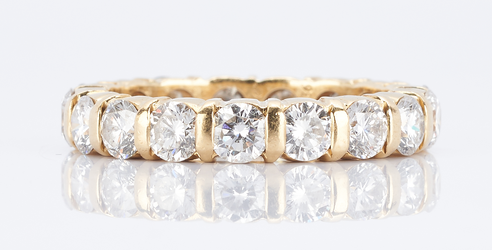 Lot 35: Ladies Cartier Diamond Eternity Ring