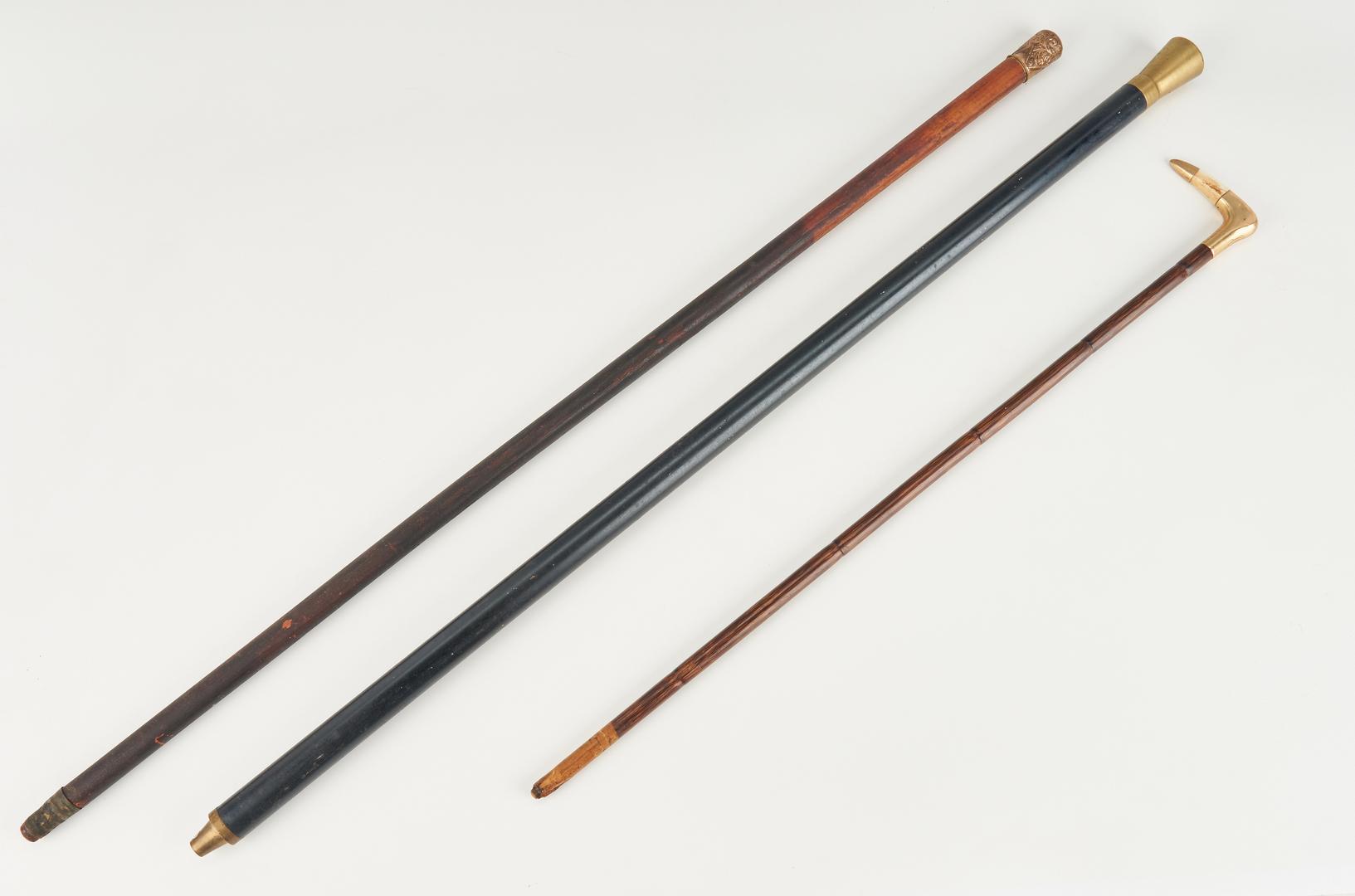 Lot 450: 3 Vintage Exercise Pins & 3 Walking Sticks
