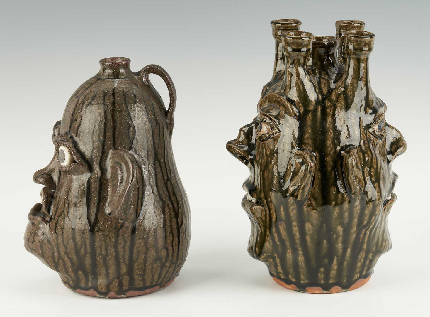 Lot 468: 2 GA Stoneware Pottery Face Jugs, incl. C. & B. Meaders, M. Hewell