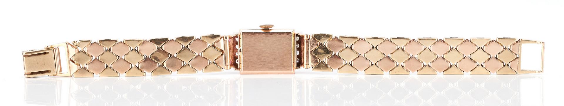 Lot 500: Ladies Tourneau 14K Gold, Ruby, and Diamond Watch