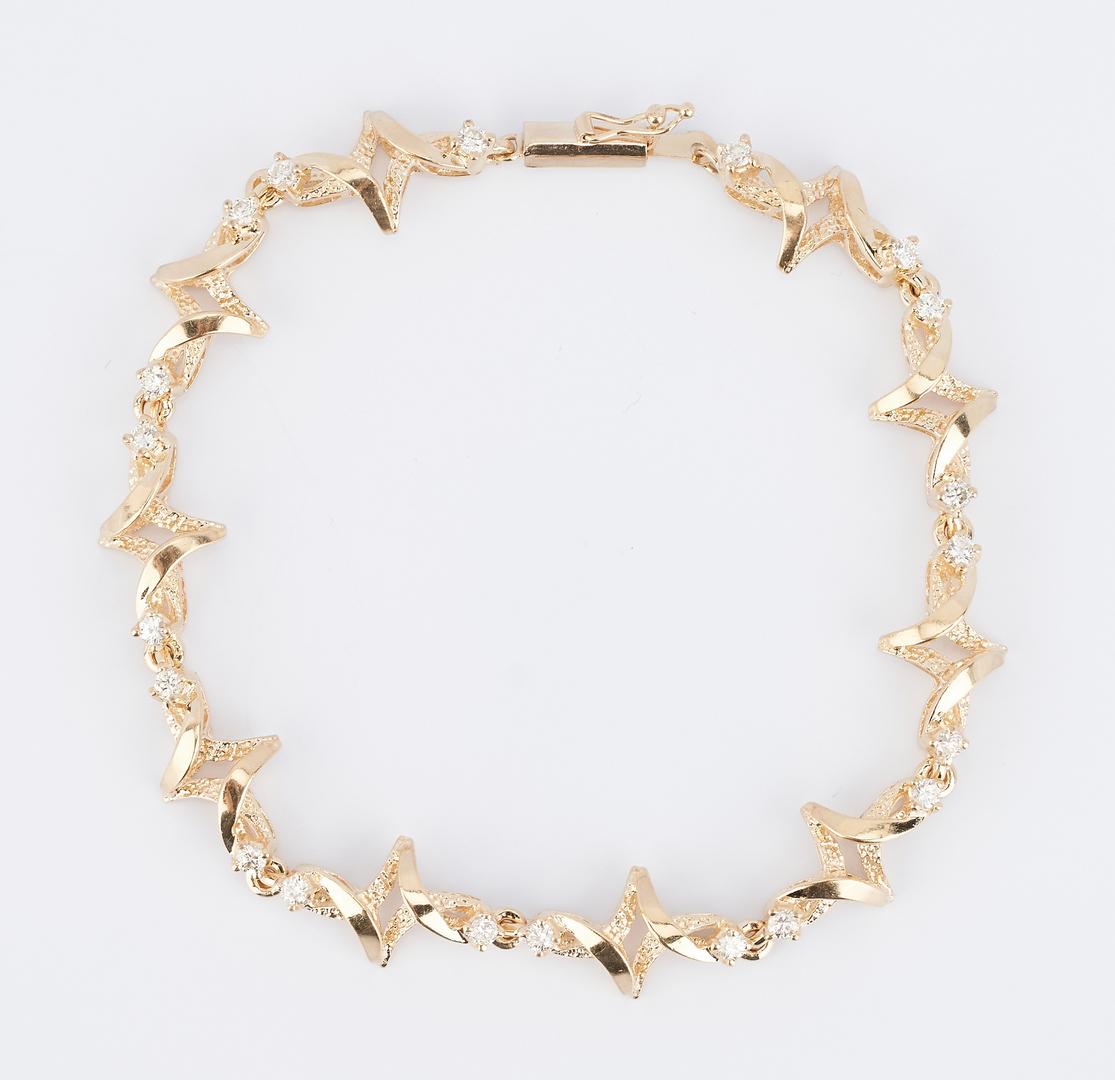 Lot 508: Ladies 14K & Diamond Bracelet