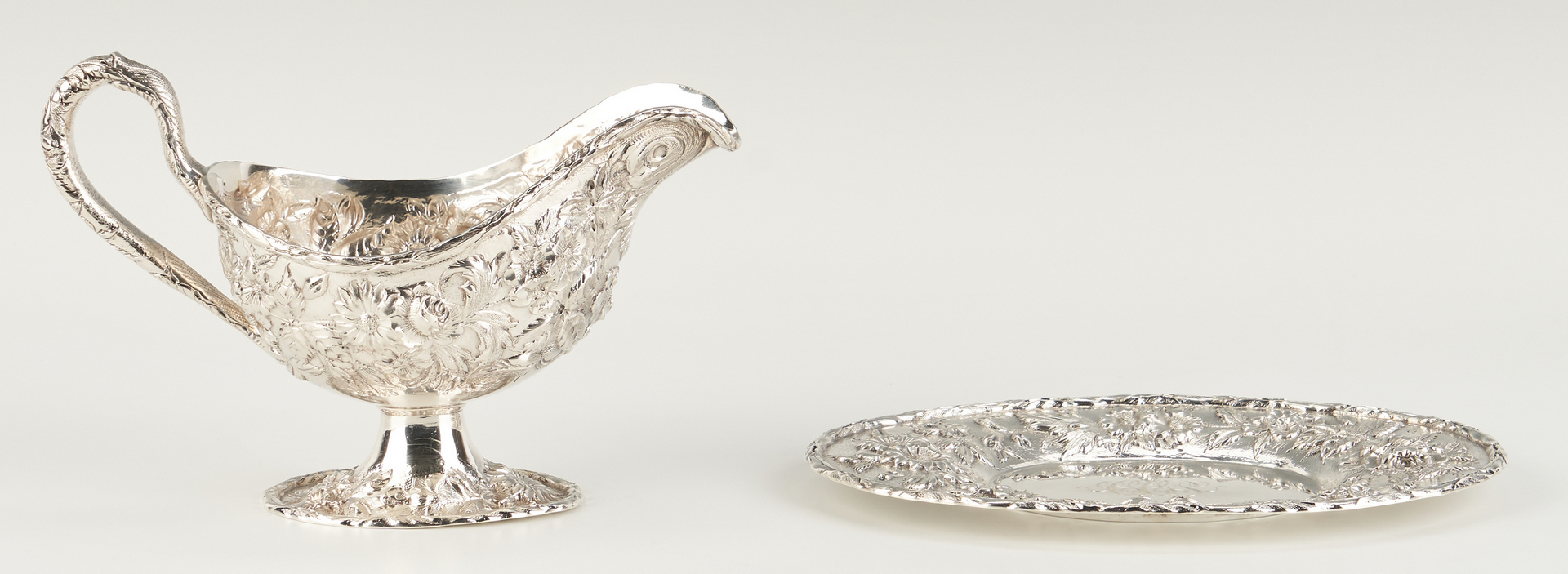 Lot 529: Kirk Repousse Silver Gravy Boat and Candy Dish