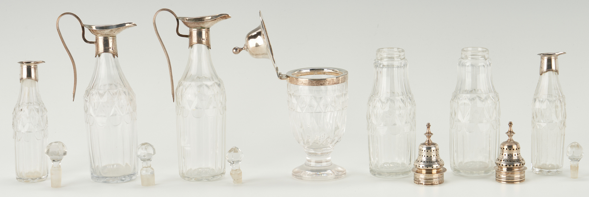 Lot 81: Geo. III Sterling Cruet Stand, Hennell Salts and spoons
