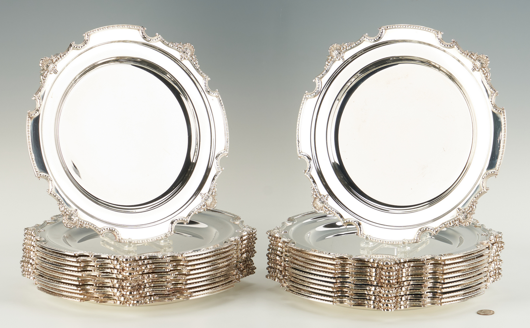 Lot 946: 24 Silverplated English Chargers