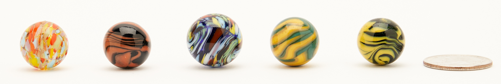 Lot 1063: 5 Christenson Agate Company Marbles, incl. Guinea Marbles