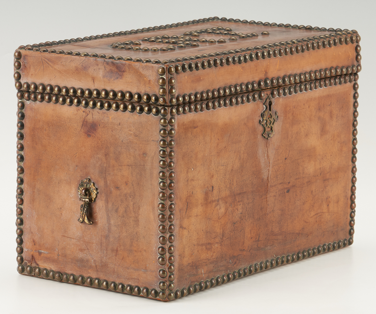 Lot 1169: European Leather Storage Box & Near East or Asian Brass Box, 2 items