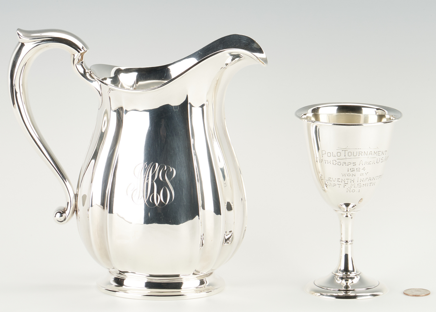 Lot 1228: Sterling Silver Water Pitcher & Polo Tournament Presentation Goblet, 2 items