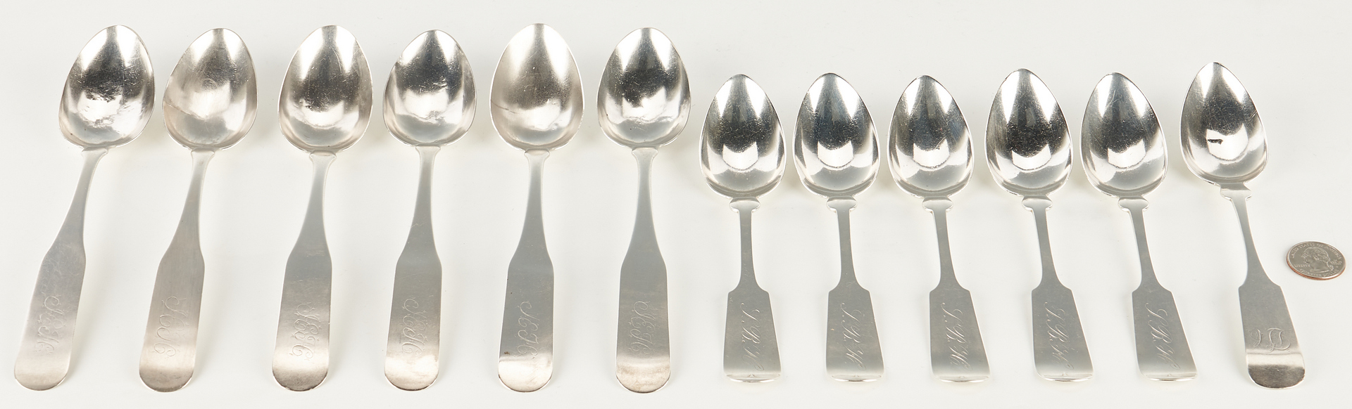 Lot 319: 12 Coin and Sterling Silver Spoons inc. Nashville, Negrin