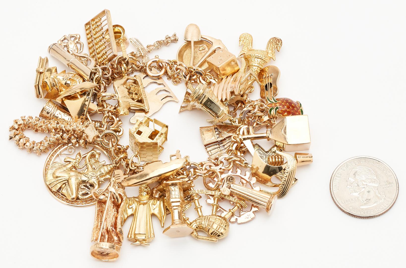 Lot 46: 14K Charm Bracelet, 37 Charms