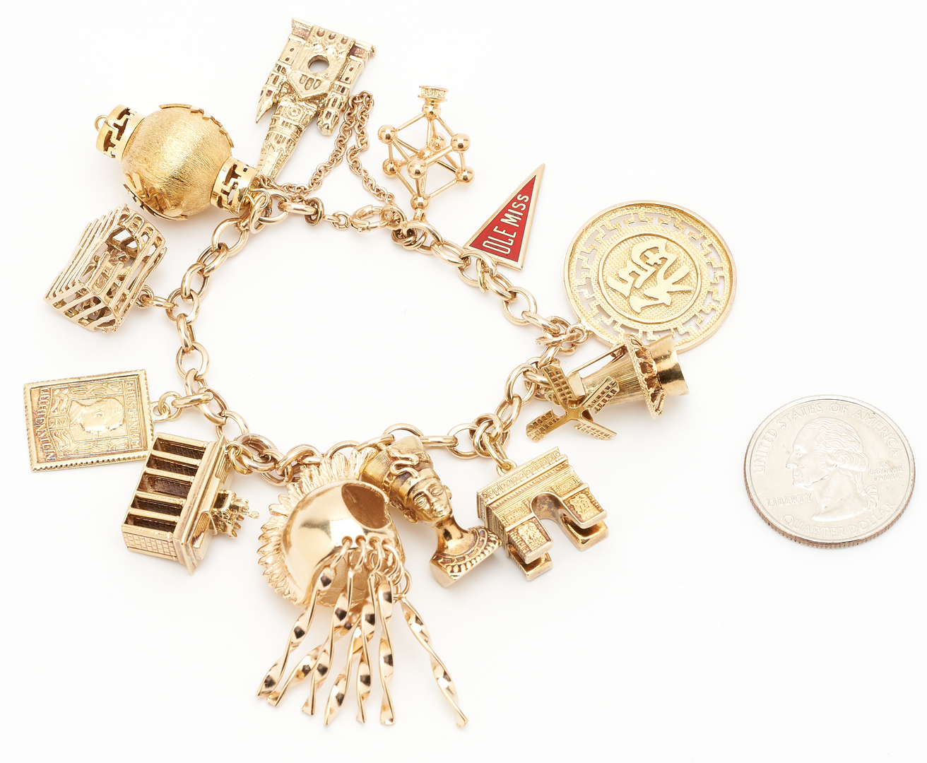 Lot 48: 14K Charm Bracelet, 12 Charms