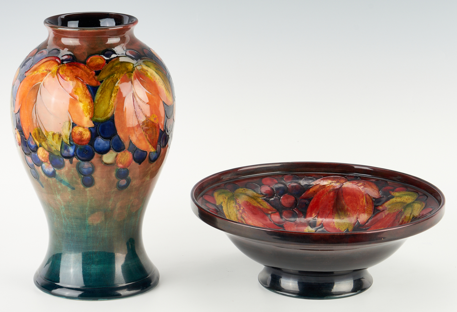Lot 518: Moorcroft Art Pottery Flambe Grape Vase & Bowl, 2 items