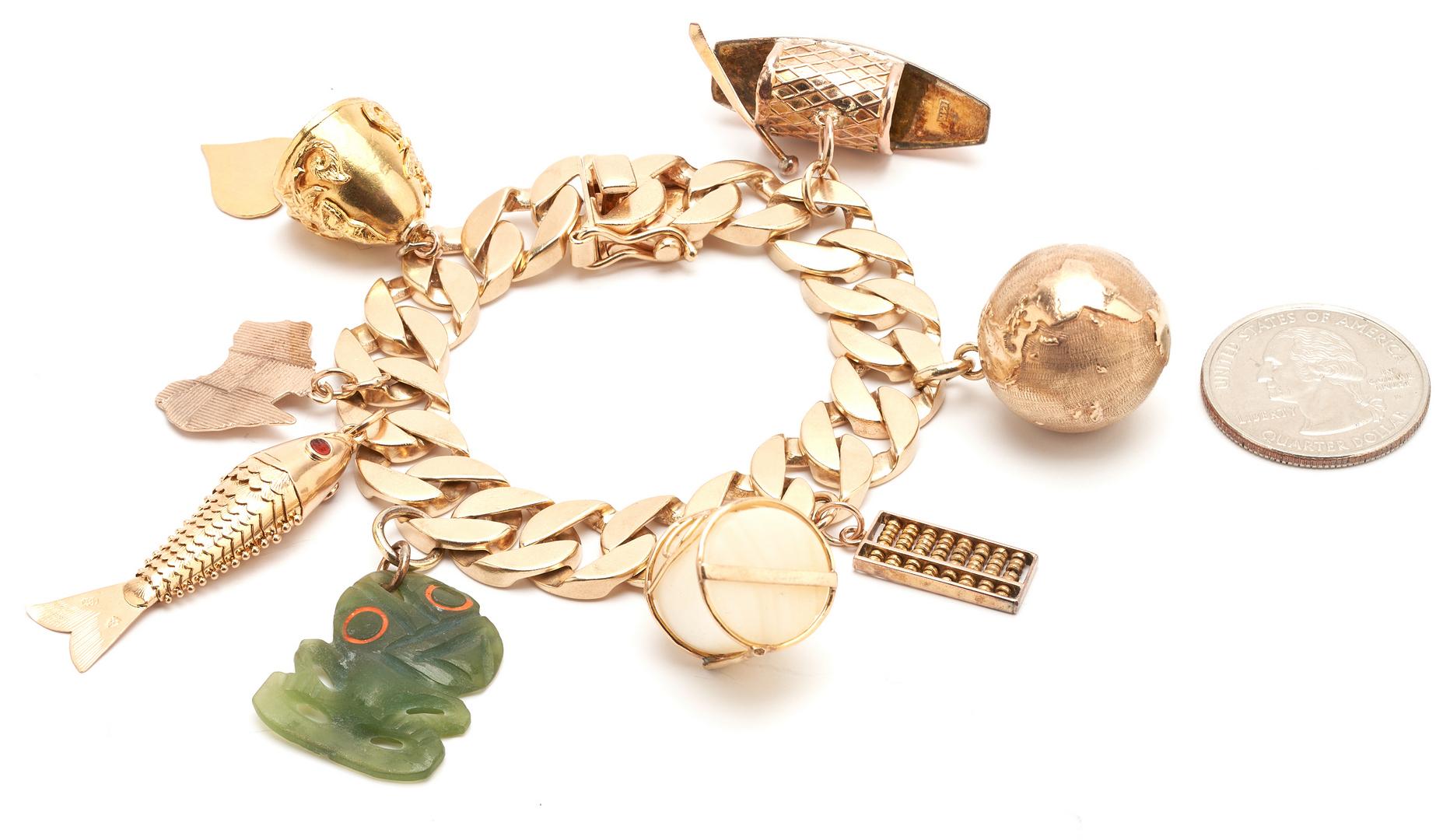 Lot 57: Ladies 14K Charm Bracelet w/ 8 Charms