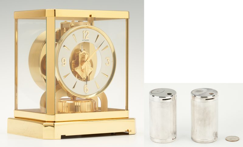 Lot 700: Le Coultre Brass Atmos Mantle Clock & Tiffany Silver Plated Lighters, 3 items