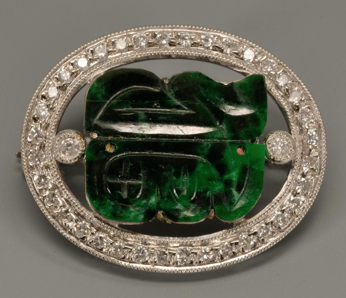 Lot 142: 18k white gold, jade and diamond brooch