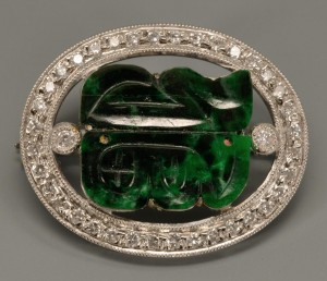 Lot 142: 18k white gold, jade and diamond brooch