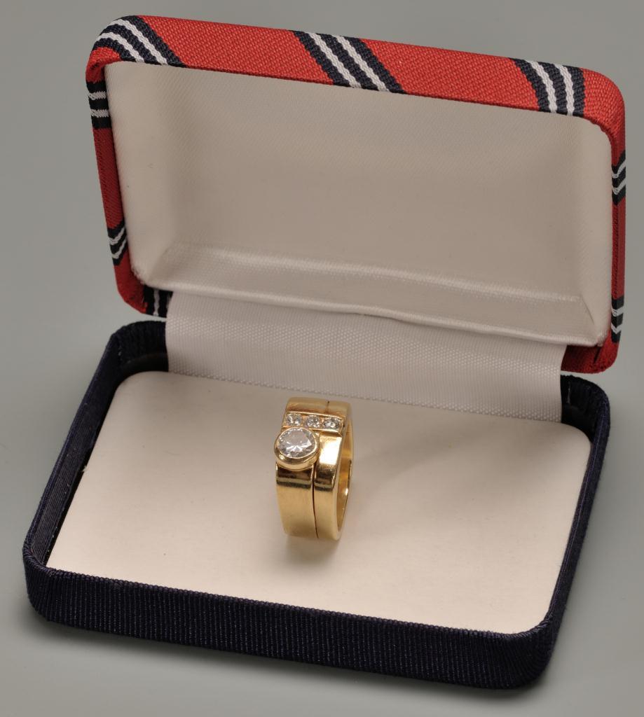 Lot 150: 14K Lady's custom diamond ring. 1.15 cts total