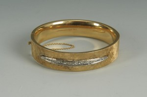 Lot 153: 14K gold and diamond bangle bracelet, 24.9 grams