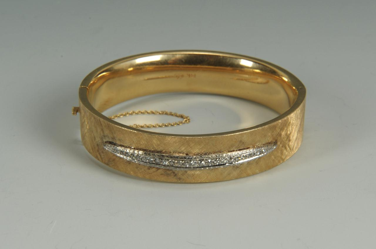 Lot 153: 14K gold and diamond bangle bracelet, 24.9 grams