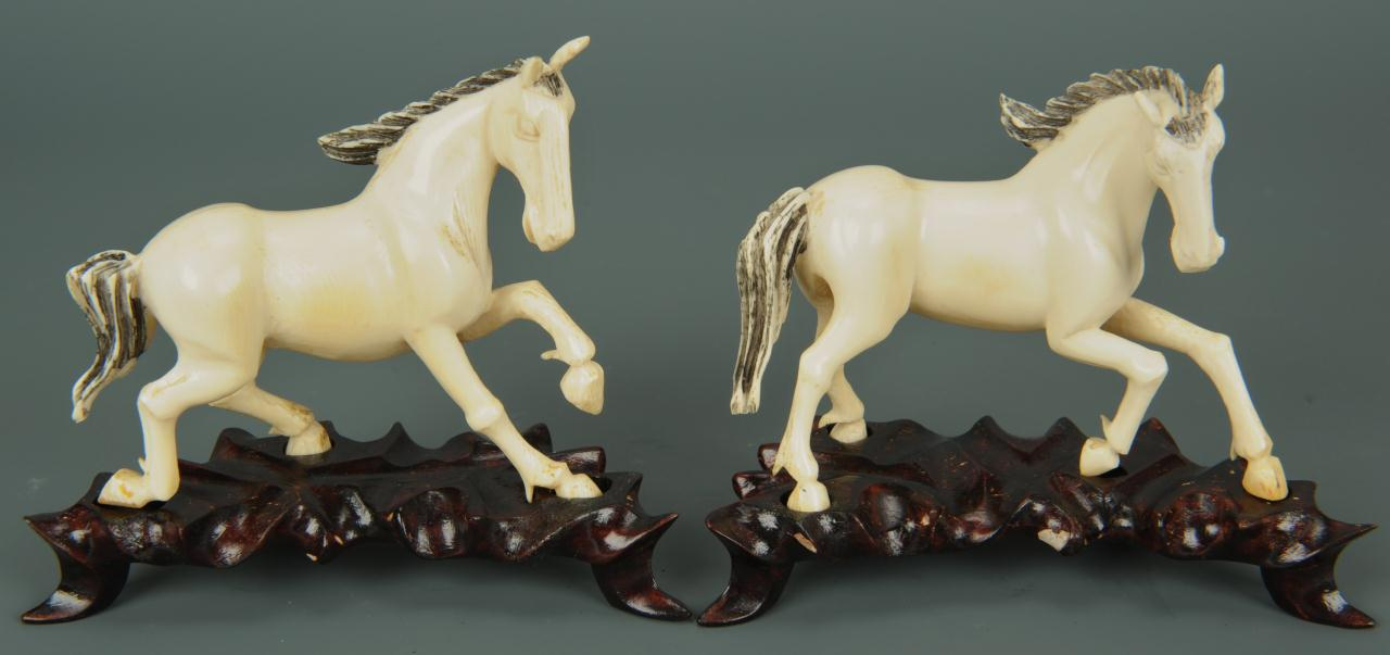 Lot 15: Eight Chinese carved ivory horses of Mu Wang
