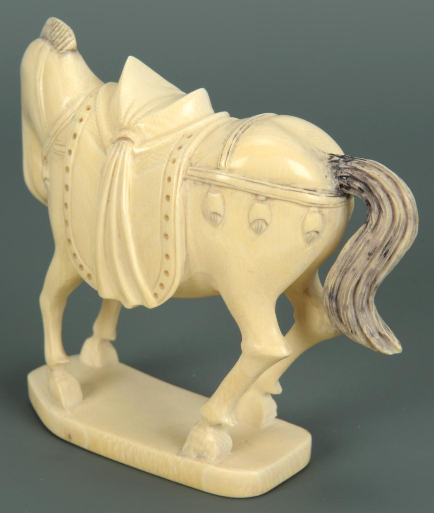 Lot 16: Finely carved ivory horse okimono
