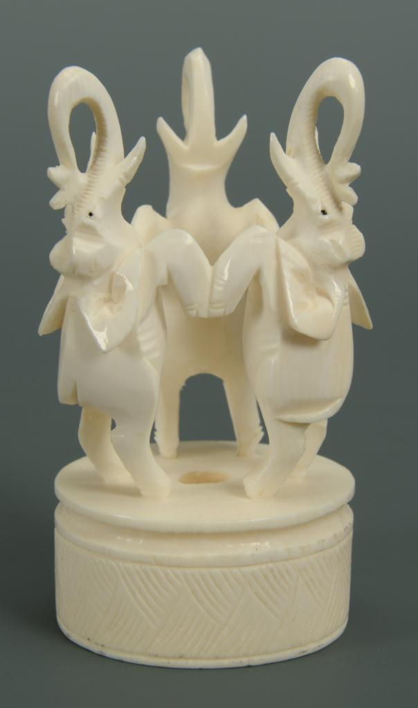 Lot 216: Chinese carved ivory elephants with puzzle ball