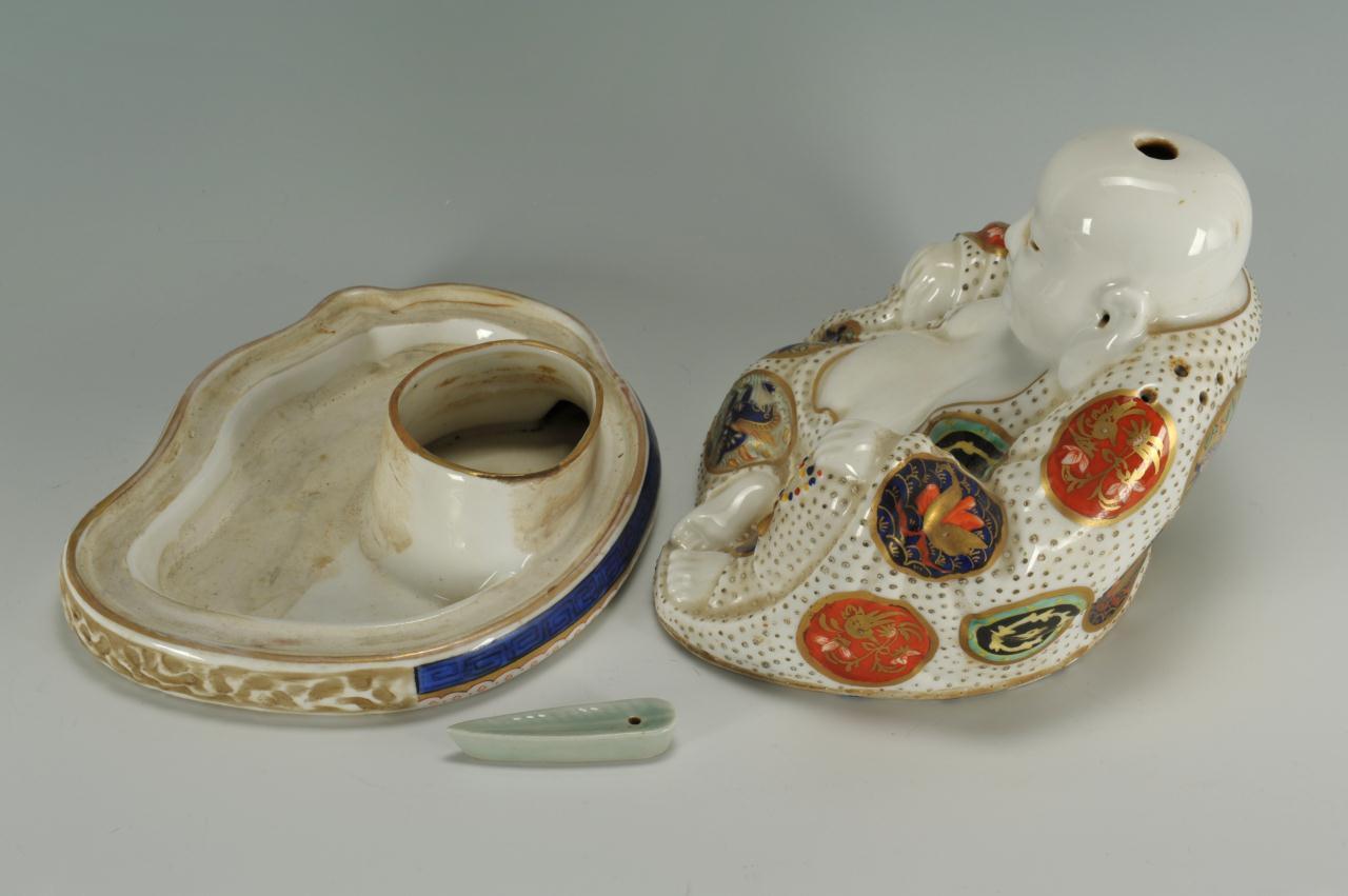 Lot 223: Porcelain Buddha inkwell or censer