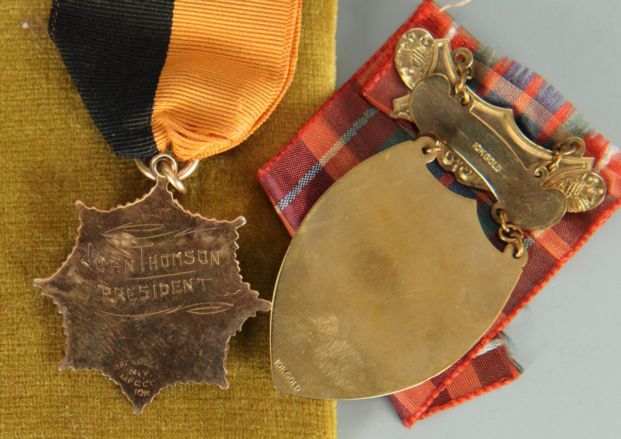 Lot 279: 3 United Scottish Clan Medals, two (2) 10K gold