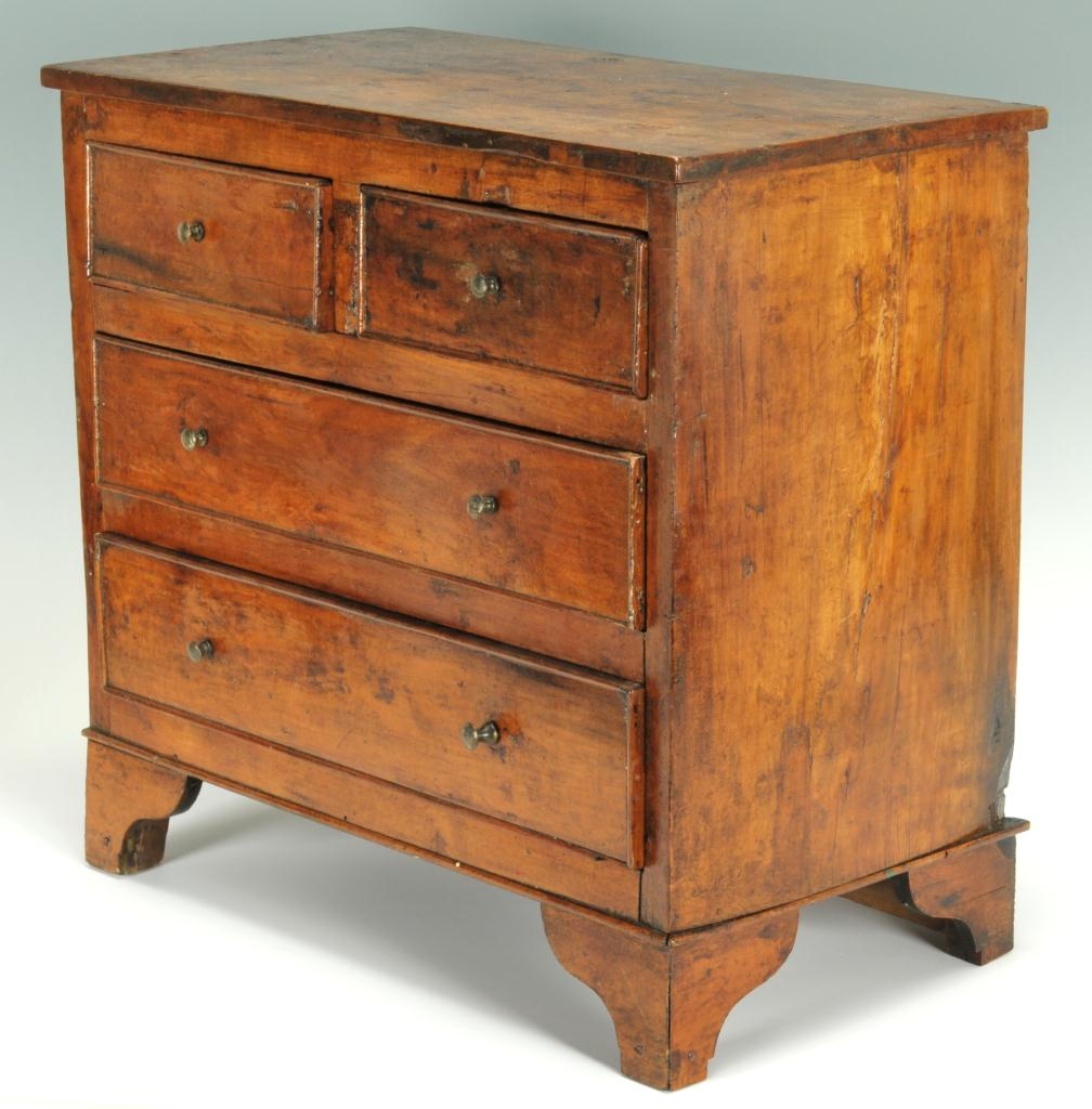 Lot 288: Miniature chest of drawers