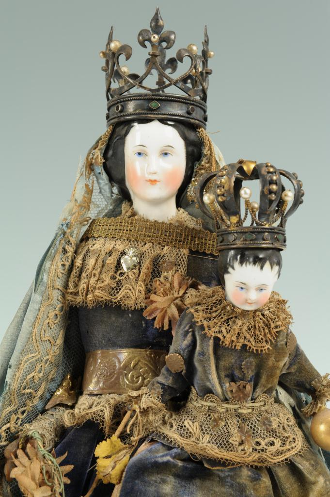 Lot 303: Porcelain Santos dolls, Madonna & Child, with crow