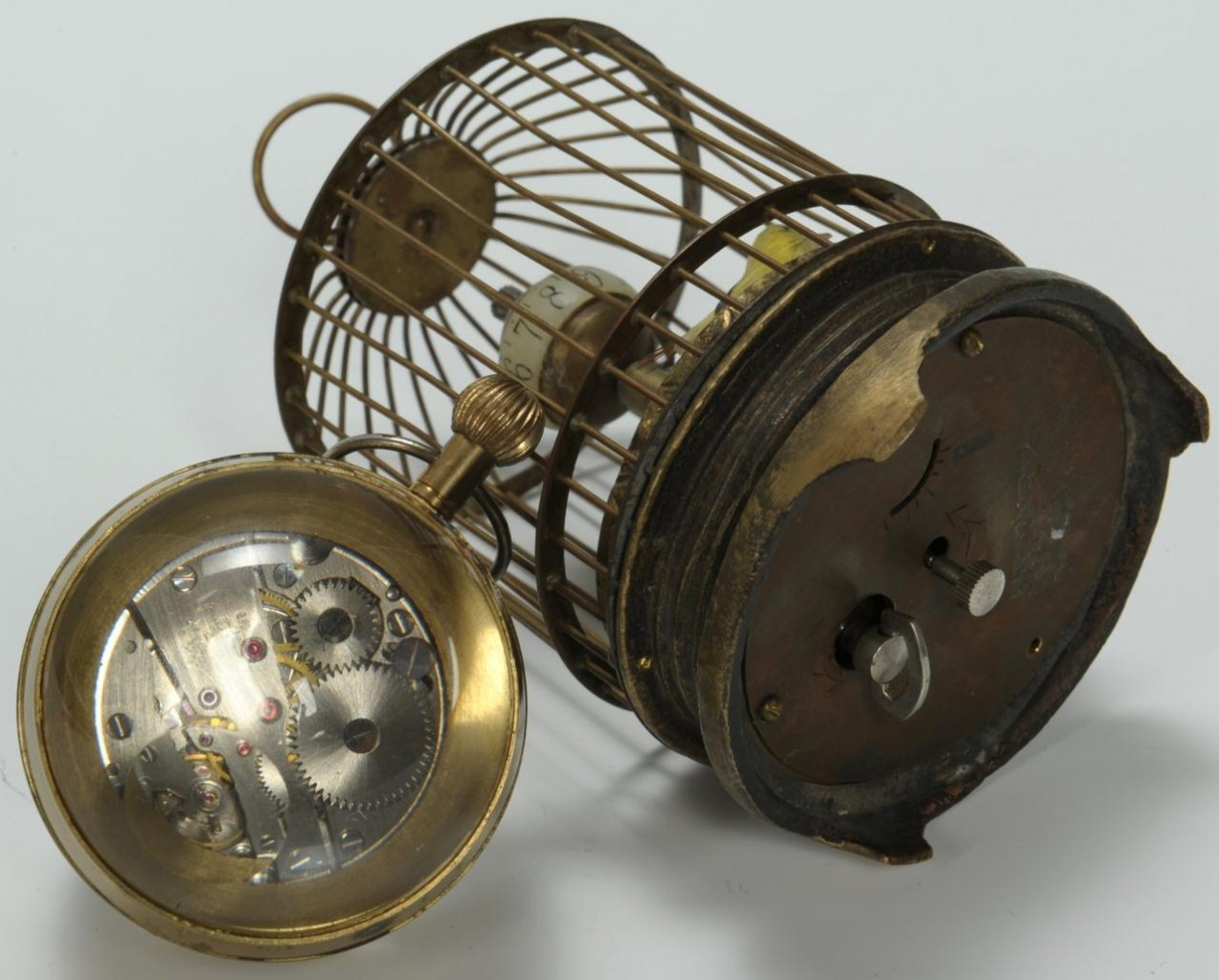 Lot 309: 2 novelty clocks: Birdcage and Paperweight