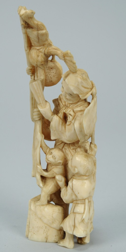 Lot 393: Ivory Okimono figure, man with monkeys