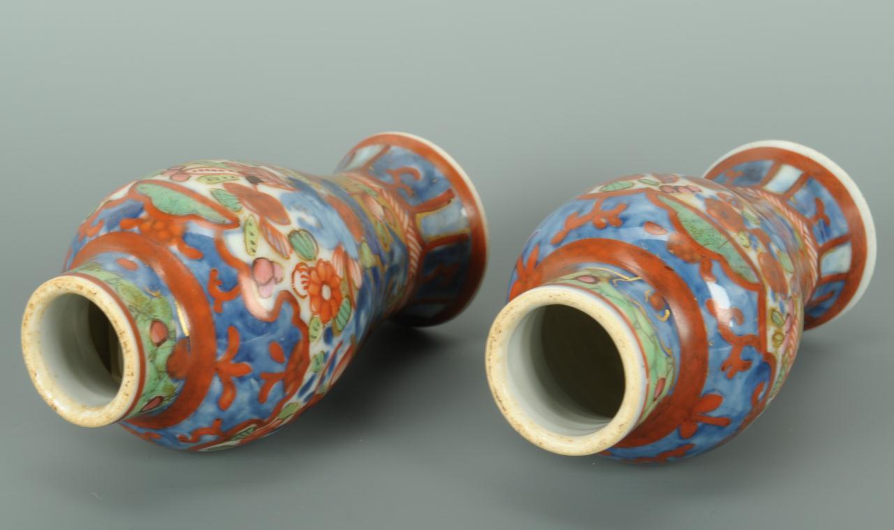 Lot 395: Pair red cinnabar vases & Pair Imari vases
