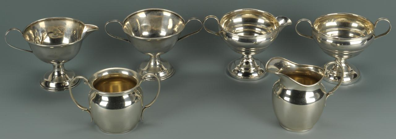 Lot 482: Three pairs sterling sugar and creamers