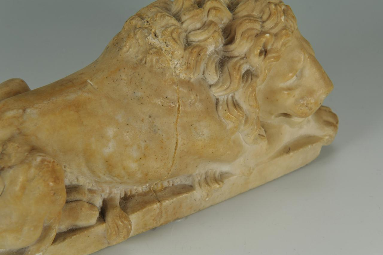 Lot 493: Pair of Marble Recumbent Lions, after Canova