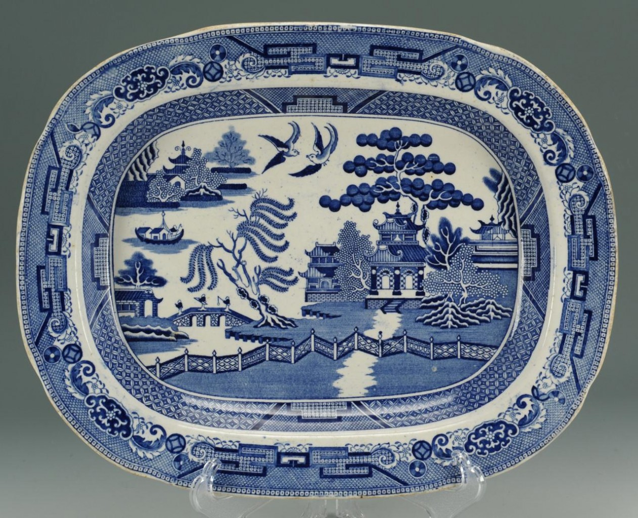 Lot 557: Two Staffordshire Platters and a Gibson Girl Plate