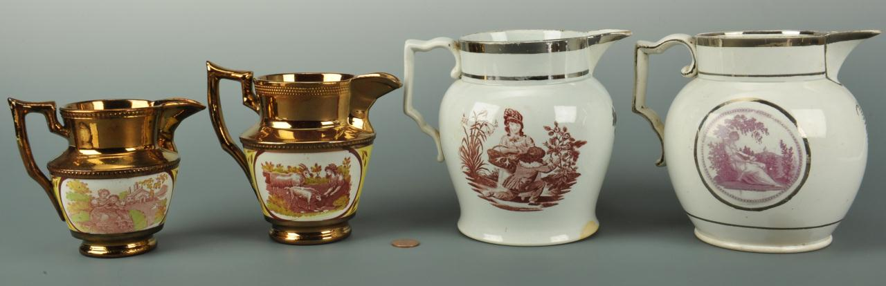 Lot 560: Four silver and copper lustre pitchers