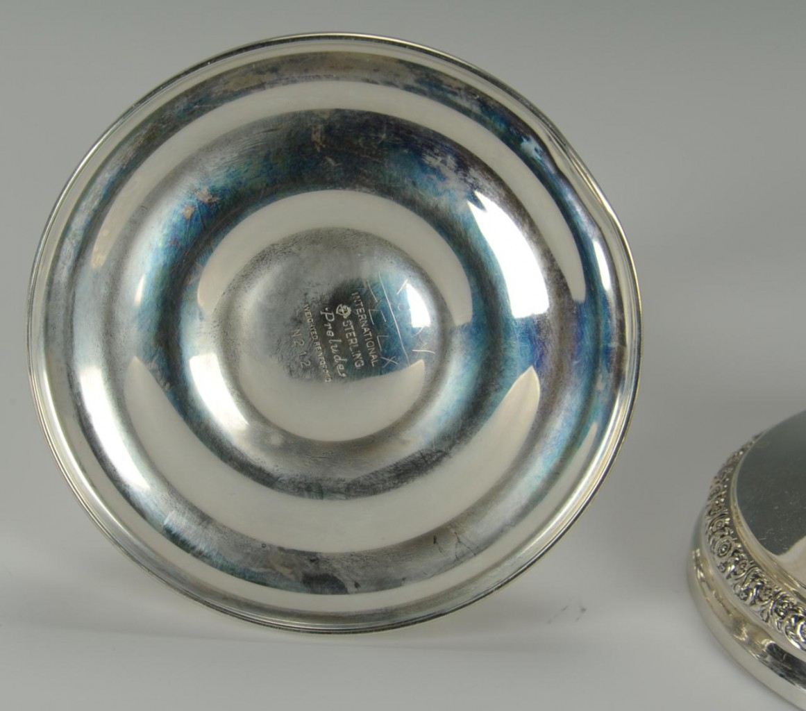 Lot 578: Four pairs sterling silver candlesticks