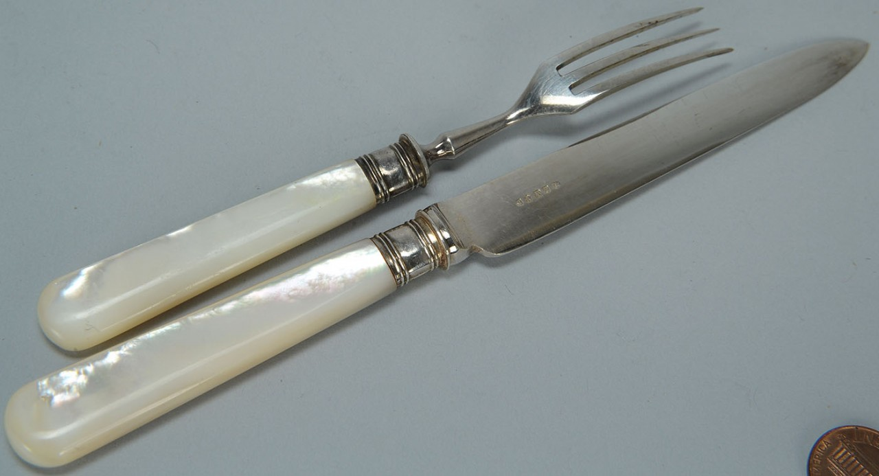 Lot 599: Boxed set s/p and mother of pearl flatware