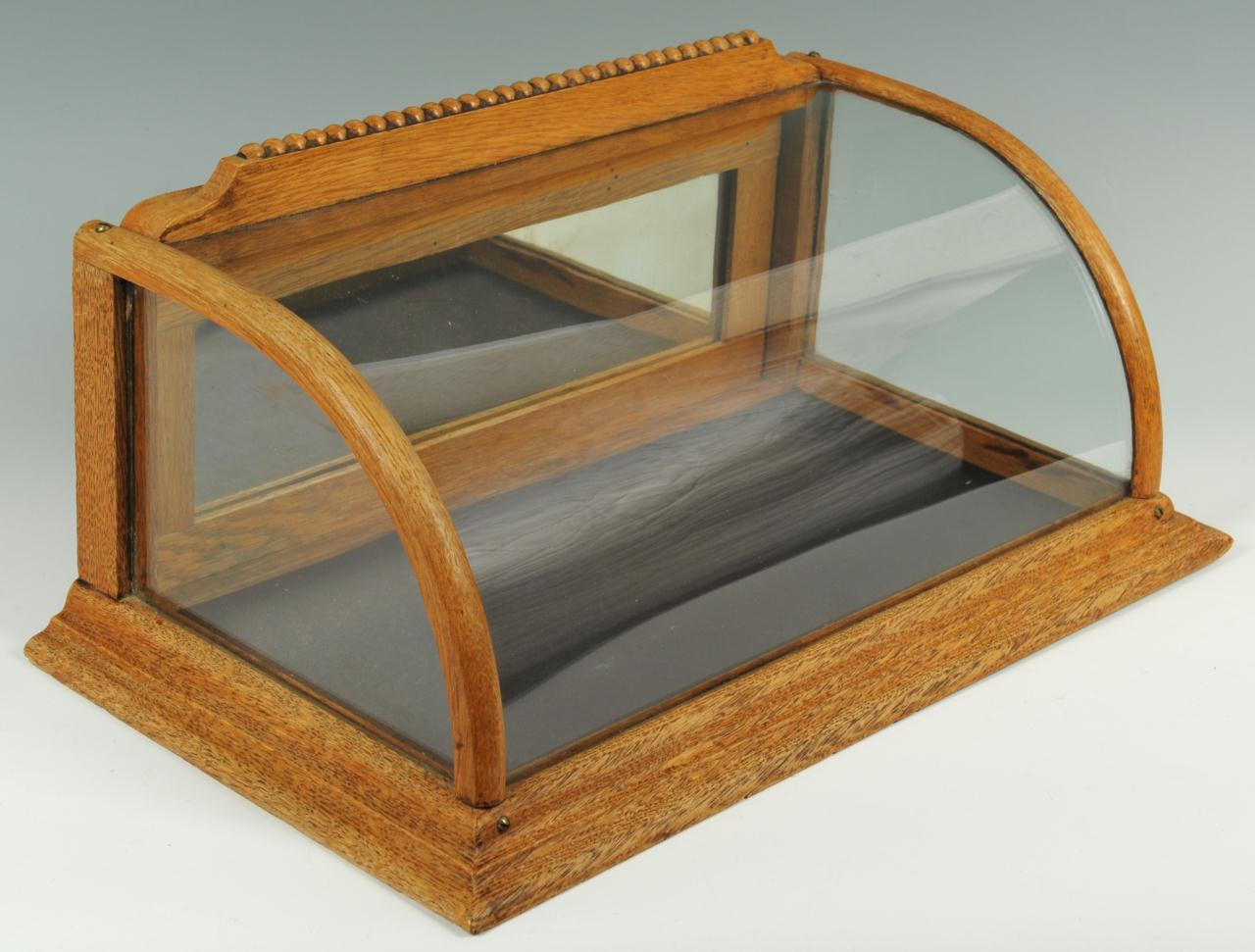 Lot 652: Oak and curved glass countertop display case
