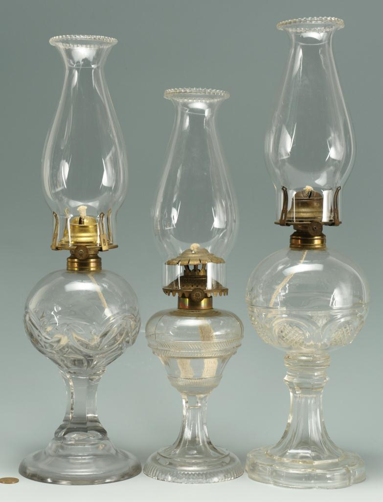 Lot 656: 3 Colorless Glass Kerosene Lamps