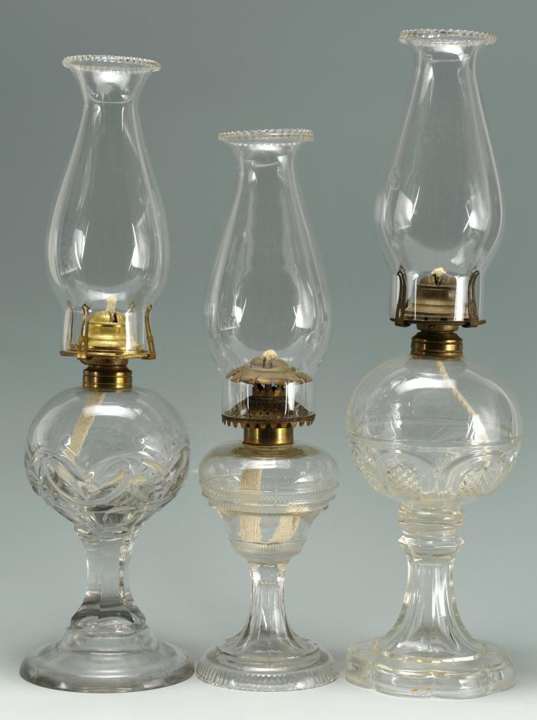 Lot 656: 3 Colorless Glass Kerosene Lamps